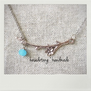the Silver Garden necklace in Cyan